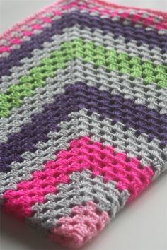 Crochet Baby Blanket Grey, Pink, Hot Pink, Green and Purple. Cool color combination.
