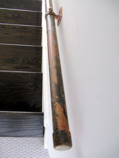 """Stair rail. (""""The copper was """"aged"""" with 2 shades of a faux patina found in art stores.  Seal with buffed beeswax."""")"""
