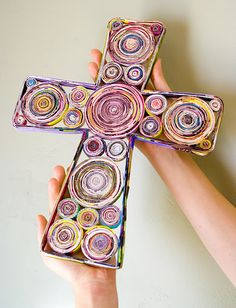 cross made from rolled magazine pages, pretty as is, but I'm wondering if it could be spray painted too?? Going to have to try this!