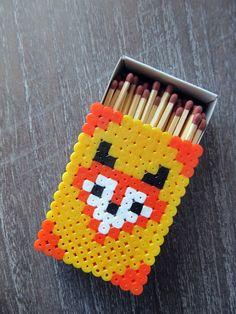 Fox perler beads on a matchbox