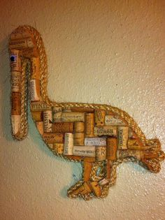 Unique Pelican wall art made with solid wood backing and real wine corks. Beautifully bordered with rope. This unique piece will be a great addition to your kitchen, bar, or man-cave. Great gift idea! Overall length is approx. 16 inches . As with all items, custom sizes accepted