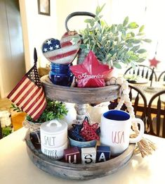 July Tiered Tray decoration ideas to glam up your home in Patriotic Spirit - Hike n Dip - - Make your July decoration even more special with the best July Tiered tray decoration ideas. These Patriotic Day decorations are easy to do. Fourth Of July Decor, 4th Of July Decorations, July 4th, Table Decorations, Centerpieces, Galvanized Tray, Kitchen Island Decor, Kitchen Tables, Kitchen Ideas