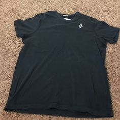 Men's Abercrombie shirt. Like new only worn a couple of times. Color is dark blue Abercrombie & Fitch Shirts Tees - Short Sleeve