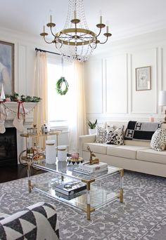 AM Dolce Vita 2016 Christmas tree, pink Christmas tree, feminine and elegant Christmas decor, Christmas tree in the foyer, Black and white Christmas tree, DIY Christmas ornaments, stylish holiday mantle, pink maroon Christmas, Christmas living room decor, Christmas ribbons, ELTE brass and lucite coffee table
