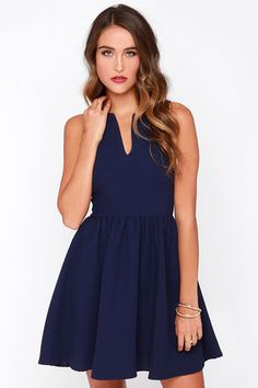 Changing your clothes can also change your attitude, so set yourself up for success with the Change of Pace Sleeveless Navy Blue Dress! Woven navy blue poly with a subtle texture begins with a fitted sleeveless bodice with side darts for shape, plus a sexy notched neckline. Gathering at the waist flares into a full skirt, while a shiny gold zipper shimmers down the back. Unlined. 100% Polyester. Hand Wash Cold or Dry Clean. Made with Love in the U.S.A.