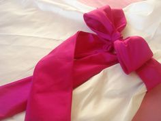 This is the flower girl sash on etsy. The same person is making our bowtie so they will match. Choose burgundy for the color.