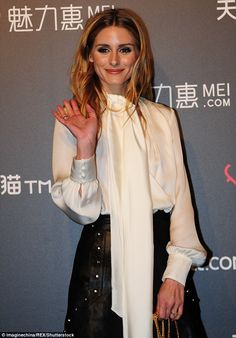 Royal wave: Wearing a loose and draping cream silk blouse, which had a long tie around he...