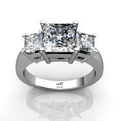 Three Stone Princess Cut Diamond Ring. -   This Past; Present and Future Ring for Square Princess Cut Diamonds uses basket style settings to showcase the diamond's brilliance.. $1949.00