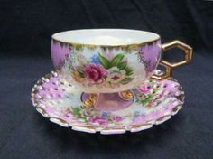 Tea cup three footed and  saucer