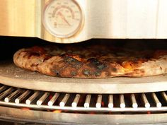 Turning my grill into a wood fire pizza oven?  Yes please!