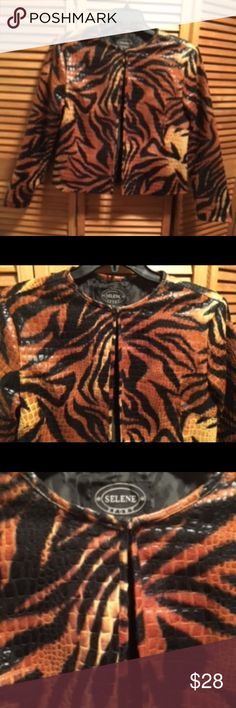 Selene Sport Animal Print Jacket Animal print jacket with raised print, 6 hook, closures, and black lining. Would look great with a black dress, black turtleneck, black top with a skirt or pants. Large. 100% polyvinyl chloride. Lining 100% nylon. Worn once. Selene Sport Jackets & Coats Blazers