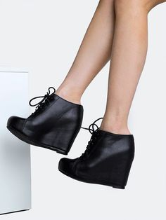 - Brand: Jeffrey Campbell - Style: Wedge Bootie - Color: Black - Dress up, down, or naked in these all day wedge booties - Laced up ankle boots have a vegan leather upper with a hidden wedge heel. - M