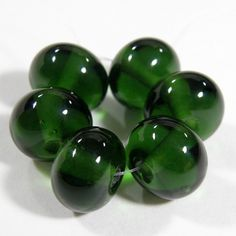 Transparent Sage Green Handmade Lampwork Glass Beads 019 Shiny (Choices of Etched, .999 Fine Silver, Shapes, Sizes, Large Hole Beads Extra) These gorgeous beads are made using glossy transparent sage green glass. They are a deep rich luxurious green. These handmade glass beads make elegant jewelry designs! They are beautiful beads that you can have in a shiny glass bead finish or go for the frosted handmade sea glass or beach glass look in an etched glass bead finish.