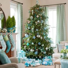 This light and airy holiday color scheme incorporates light green, bright blue, and silver to create a sophisticated Christmas living room. Hang light green-and-blue oversize stockings from your mantel beneath potted lemon cypress trees wrapped in teal paper and green ribbon. Decorate your Christmas tree with an assortment of blue, silver, and green glass ornaments, and color-coordinate a sea of wrapped packages in blue-and-white to complete the color scheme.