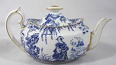 Teapot with Yum-Yum as a bride.  This series of china (The Mikado Collection) was made by a rival of Royal Dolton, and it was intended to be compatible with Blue Willow