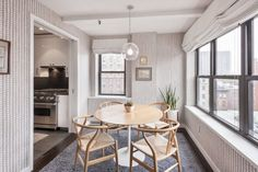 We love everything about the breakfast nook. The light fixture. The plants. And the shades are motorized!  #refinery29 http://www.refinery29.com/2016/04/108928/alexis-bledel-vincent-kartheiser-brooklyn-heights-penthouse-apartment#slide-3