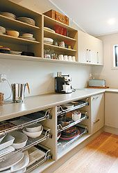 A scullery (this one modern) was used to do the dirty washing up and storage and was separate from the visible kitchen...i want one!