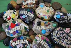 Rocks, old tiles, marbles, glass beads, small toys, scrabble tiles...ready to be grouted up and placed around the garden