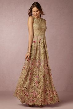 Fable Gown-- For the bohemian bride looking for something truly unique, Brazilian designer Patricia Bonaldi enchants with this ultra-femme gold gown, complete with a peekaboo bodice and cascading pink floral applique.