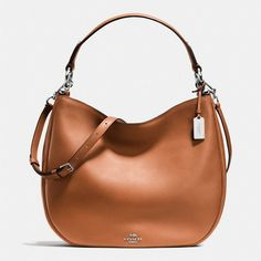 Coach Nomad Hobo ($495) ❤ liked on Polyvore featuring bags, handbags, shoulder bags, brown, coach purses, leather crossbody purse, brown leather crossbody, coach handbags and leather hobo shoulder bag