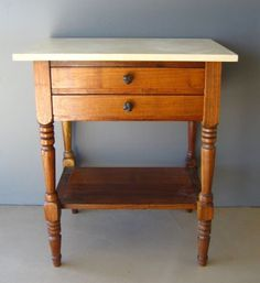 marble top on wooden side table
