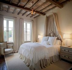 In Rome, headboards were considered luxuries among the wealthy.  This beautifully carved headboard is softened by the fabric treatment - it would certainly make you feel like a princess!