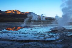 Sunrise on geyser field El Tatio, Chile. Sunrise on geyser field El Tatio in Ata , Charles Darwin, Chile, Geothermal Energy, Hotels, Andes Mountains, Landscaping Images, Lava Flow, Fjord, Yellowstone National Park