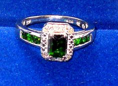 http://stores.ebay.com/JEWELRY-AND-GIFTS-BY-ALICE-AND-ANN  Emerald cut Russian Diopside Diamond Ring 1.02ctw Size 7  Sterling Silver 1.02ctw  Russian Chrome Diopside and Diamond Ring.   ring size 7   Product Information Product Type: 	Ring 	           Material Type: 	Silver Style: 	Cocktail 	          Material Color: 	White  	 	         Material Purity: 	Sterling  Primary Stone /  Chrome Diopside  Shape: 	emerald cut octagon 	Count: 	1.00 Cut: 	Brilliant 	Composition: 	Natural Color: 	Green…
