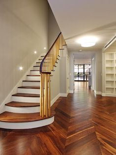 herringbone pattern hardwood floor...gorgeous.