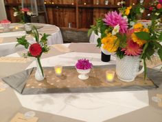 White vases with bright orange and pinks