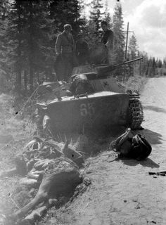 Finnish soldiers and one T34