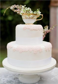 An adorable idea for a cake topper! A vintage tea cup with dried flowers.