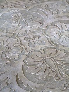 Stenciled plaster for table tops - http://www.diyhomeproject.net/stenciled-plaster-for-table-tops