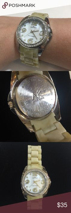 AK Anne Klein watch AK Anne Klein watch. Little bit over 7 inches around cream and silver watch with rhinestone trim and white face. Stainless steel back and water resistant up to 100 feet. Links can be taken out to make this watch smaller. Anne Klein Accessories Watches