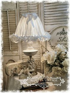 A sweet Tattered Linen Shade over a vintage cherub lamp!