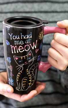 "It didn't take much for you to love your furry friend -- just like that you were family. Put that unconditional love on display with this orange-striped kitty mug that reads, ""You had me at meow."""