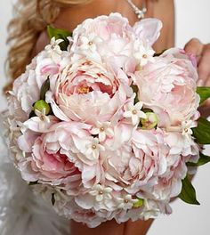The FTD® Serene Highness™ Bouquet is a blushing display for sweetnes that will make any bride smile. Gorgeous pink peonies show off their amazing texture accented with white stephanotis blooms and tie