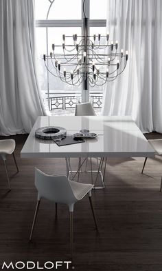 A stunning center piece to a contemporary or modern dining room. The Modloft Clarges dining table seats 8 and features a polyurethane lacquer top (black or white) with stainless steel wiry base. Paired here with Modloft Langham dining chair. All available in our quick-ship program for immediate delivery.