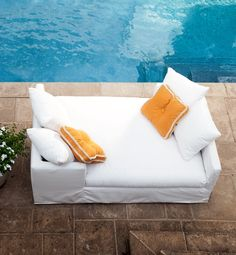 """Lee Industries' slipcovered Nandina double daybed is a modern weatherproof """"tete-à-tete,"""" (French for """"head-to-head"""") where loungers can face each other while lying down. Constructed of marine-grade sustainable birch, quick-drying foam cushions, assembled with waterproof adhesives and stainless staples, there are over 200 fabric choices, making this a cozy destination, no matter what your design."""