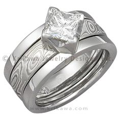Modern Scaffolding Engagement Ring with Princess-Cut Diamond and Etched Platinum Mokume Band - This unique contemporary engagement ring is designed to scaffold around a wedding band (priced separately). The wedding band cleverly slides in between the two plain bands of the engagement ring. Enjoy the versatility of being able to change the look of your engagement ring! - This Modern Scaffolding Engagement Ring has been customized with a princess-cut diamond. This bridal set features a…
