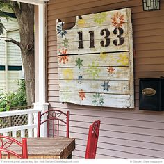 You could use an old pallet to make a new end table or wall planter for your patio — but here's an even easier project: Use it as a canvas. Paint it and hang it on a wall outside. It's a big enough surface so there's no problem seeing these house numbers from the street | Garden Gate eNotes