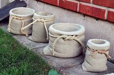 concrete planters look like burlap pouches . A tutorial for making concrete bags! concrete planters look like burlap pouches . A tutorial for making concrete bags!concrete planters: looks like cloth grain sacks with hemp rope and everything. Cement Art, Concrete Crafts, Concrete Projects, Diy Concrete Planters, Planters Flowers, Diy Cement Planters, Garden Planters, Concrete Bags, Concrete Cloth