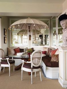 This makes me want to have an umbrella table in my dining room. :D