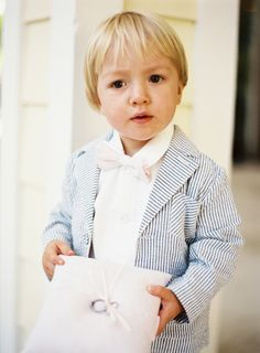 ad134b6446d Seersucker coat and bow tie for this handsome ring bearer. Photo  Ozzy  Garcia Ring