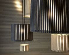 The Slamp Avia suspension light. Fluid and dynamic, Avia is a miniature piece of architecture, perfect for adding stature to the home. The lamp is availa. Wood Pendant Light, Mini Pendant Lights, Drum Pendant, Laser Cut Lamps, Showroom Interior Design, Diy Light Fixtures, Wooden Lamp, Lamp Design, Light Design