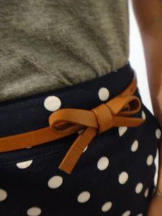 Grey tee + navy/white polka dot skirt + camel accents