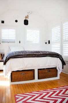 Photo: High bed frame with storage underneath (Link - Pull It Off: Beds in Front of Windows)