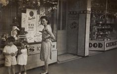 Digital Photograph - Mother, Boy & Girl Looking in Milk Bar Front Windows, Moonee Ponds, 1949 - Museum Victoria