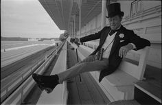 "Hollywood icon Rex Harrison poses for photographer Terry O'Neill between takes of ""A Flea in Her Ear"" during the height of the actor's career in 1968. For six decades, O'Neill photographed the greats of screen and stage to presidents, prime ministers and rock stars."