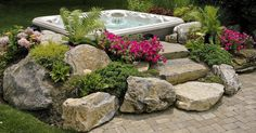 This Hot Tub was installed before we arrived. Our client asked us how we could make it look better. I suggested boulders and planting. Now it looks like you are…